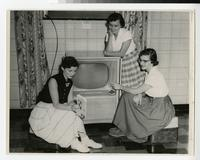 1957 Students Relaxing Around a Television
