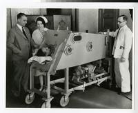 1940s Nursing Student Caring for a Patient in an Iron Lung During a Clinical Experience