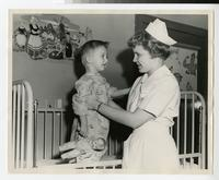 1950s Nursing Student Caring for a Young Boy in a Clinical Experience