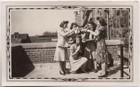 1941 May Five Students Performing a Baptism outside Tower Hall