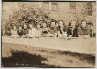 1940 Ten Students Leaning Against a Wall Outside of Tower Hall