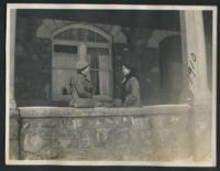 1910 Students Sitting on Tower Hall's Porch