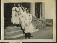1911 Students Wearing White Dresses in Front of Tower Hall